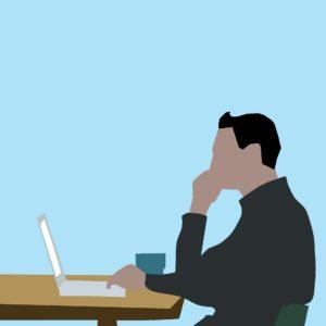 ノートパソコンに向かう男性のイラスト
